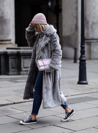 No matter where you go over the course of the day, you'll be stylishly prepared in a grey fur coat and sunglasses. For something more on the daring side to finish off this outfit, opt for a pair of black and white canvas low top sneakers. This outfit is super comfortable and will help you out in in-between weather.