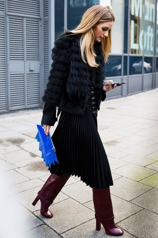 Olivia Palermo wearing Black Fur Jacket, Black Button Down Blouse, Black Pleated Midi Skirt, Burgundy Leather Knee High Boots