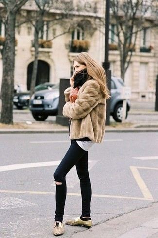 Consider teaming a camel fur jacket with black ripped slim jeans to achieve a chic look. Finish off your look with tan embellished leather oxfords.