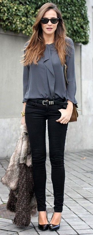 A grey fur jacket and black slim jeans are a great outfit formula to have in your arsenal. Round off this look with black leather pumps.