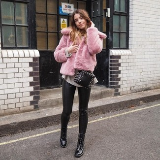 How to wear: pink fur jacket, beige oversized sweater, black leather skinny pants, black leather lace-up flat boots