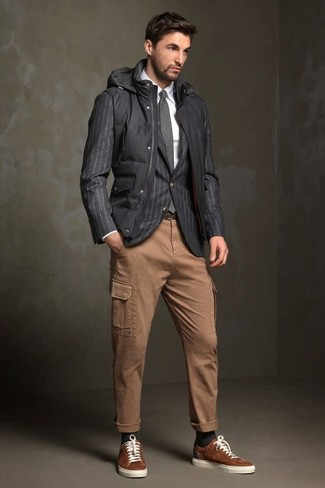How to wear: black quilted gilet, charcoal vertical striped blazer, white dress shirt, khaki cargo pants
