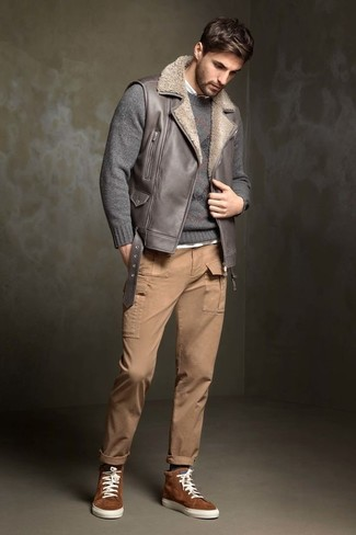 How to wear: grey leather gilet, grey crew-neck sweater, white long sleeve shirt, khaki cargo pants