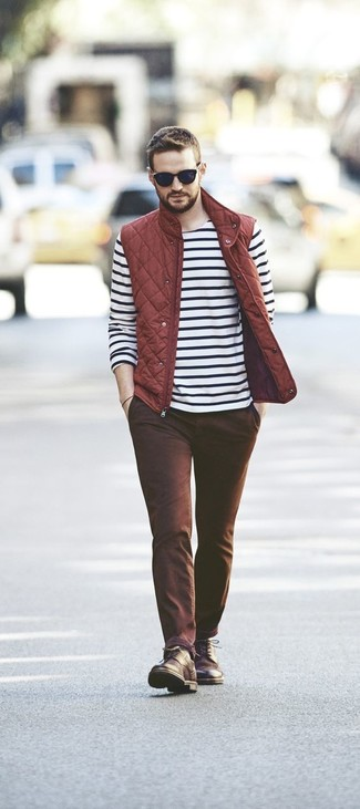 How to wear: red quilted gilet, white and black horizontal striped long sleeve t-shirt, brown chinos, dark brown leather casual boots