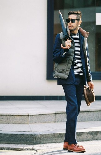 How to wear: olive quilted gilet, navy suit, black and white horizontal striped crew-neck sweater, tobacco leather casual boots