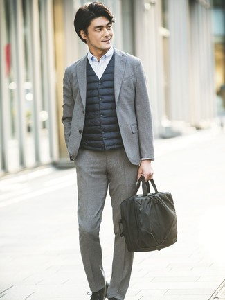 How to wear: black gilet, grey wool suit, light blue vertical striped dress shirt, black leather derby shoes