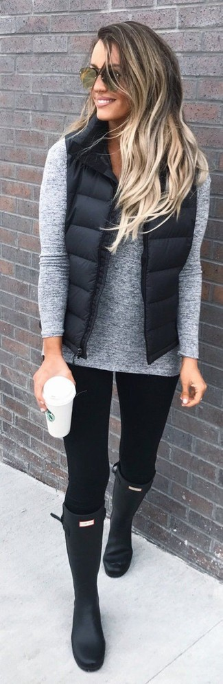 How to wear: black quilted gilet, grey v-neck sweater, black leggings, black rain boots