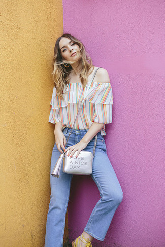 How to wear: silver leather crossbody bag, white leather gladiator sandals, light blue jeans, multi colored vertical striped off shoulder top