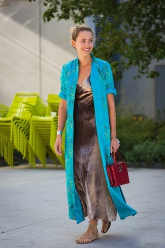 How to wear: burgundy leather satchel bag, beige leather gladiator sandals, silver maxi dress, aquamarine duster coat