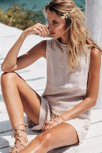 How to wear: gold headband, beige leather gladiator sandals, beige shorts, beige silk sleeveless top