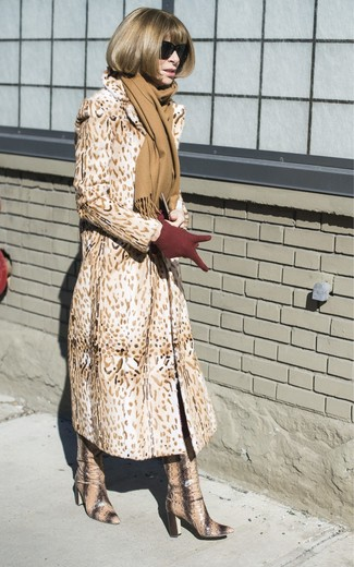 How to wear: tan scarf, burgundy wool gloves, tan snake leather knee high boots, tan leopard fur coat