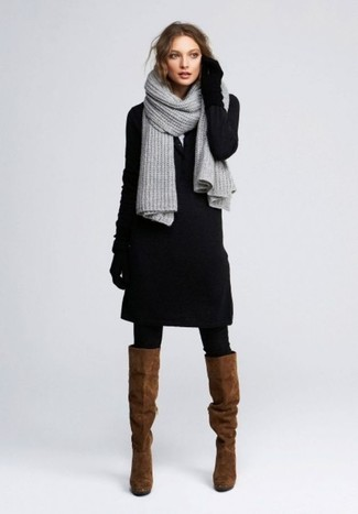 How to Wear Brown Suede Knee High Boots: Reach for a black sweater dress to pull together a totaly chic outfit. If in doubt about what to wear in the shoe department, add brown suede knee high boots to the equation.
