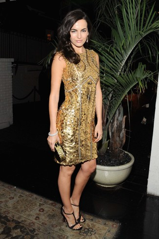 Camilla Belle wearing Gold Beaded Sheath Dress, Black Leather Heeled Sandals, Gold Sequin Clutch