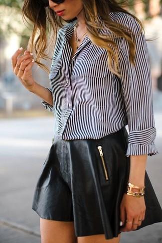 How to wear: gold bracelet, black leather skater skirt, black and white vertical striped dress shirt