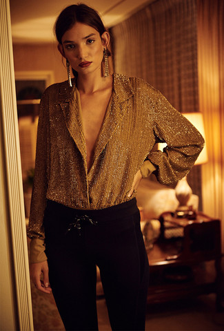 How to wear: gold button down blouse, black skinny pants, gold earrings