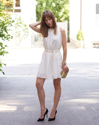 How to wear: gold bracelet, gold clutch, black suede pumps, white silk swing dress