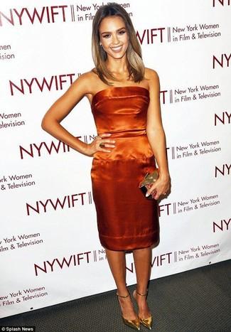 How to wear: gold clutch, gold leather pumps, orange satin sheath dress