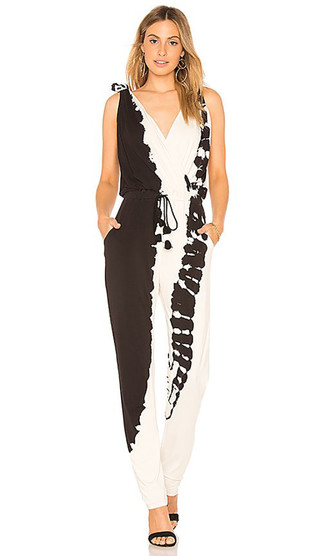 How to wear: gold earrings, black suede heeled sandals, black and white tie-dye jumpsuit