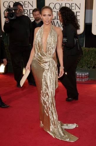 Jennifer Lopez wearing Gold Evening Dress, Beige Leather Clutch, Gold Bracelet