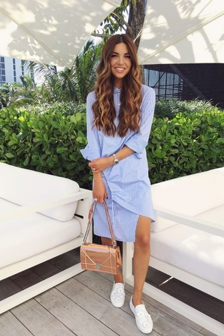 How to wear: gold leather satchel bag, white embellished slip-on sneakers, light blue vertical striped shirtdress