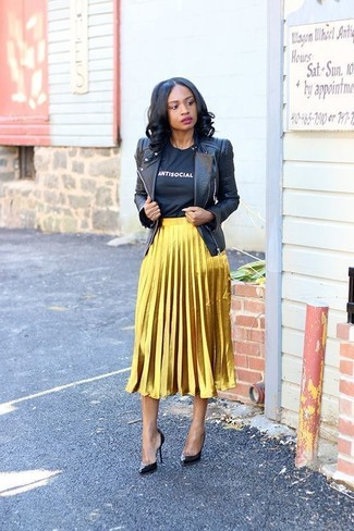 How to wear: black leather pumps, gold pleated midi skirt, black and white print crew-neck t-shirt, black leather biker jacket