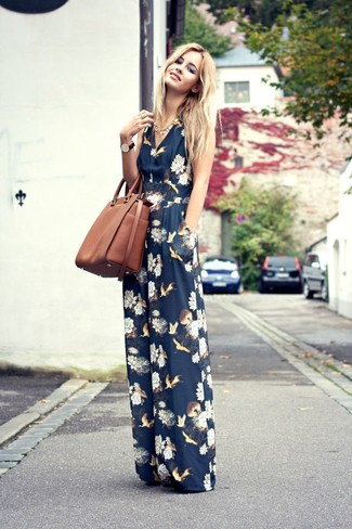 How to wear: gold necklace, brown leather tote bag, navy floral jumpsuit
