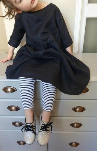 How to wear: gold oxford shoes, white and black horizontal striped leggings, black cotton dress