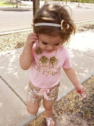 How to Wear Gold Sandals For Girls: This combo of a pink t-shirt and gold shorts has all the potential to become your little angel's favorite. Gold sandals are a nice choice to round off this ensemble.