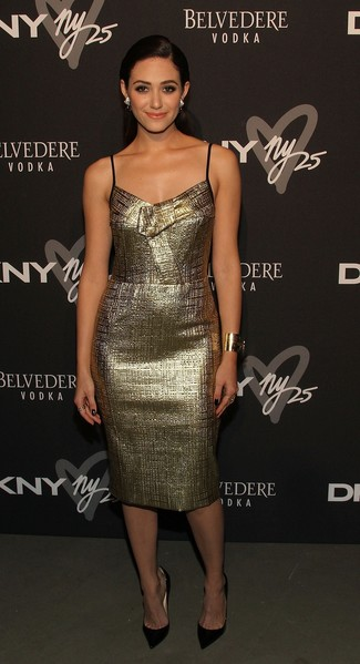 Emmy Rossum wearing Gold Sheath Dress, Black Leather Pumps, Gold Bracelet, Silver Earrings