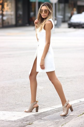 How to wear: gold sunglasses, beige leather heeled sandals, white tuxedo dress