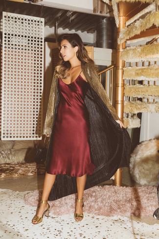 For effortless style without the need to sacrifice on comfort, we love this combination of outerwear and a burgundy silk cami dress. Bring a touch of sophistication to your outfit with gold leather heeled sandals. Stick with this one if you're in search of a standout summer ensemble.