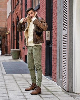 How to wear: brown leather casual boots, green cargo pants, white cable sweater, brown shearling jacket