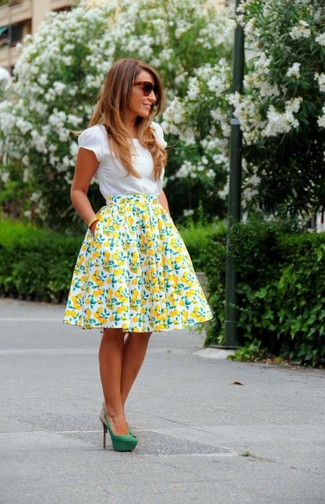 How to wear: dark brown sunglasses, green suede pumps, white and yellow print full skirt, white crew-neck t-shirt