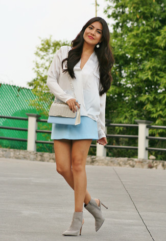 How to wear: light blue leather crossbody bag, grey cutout suede ankle boots, light blue mini skirt, white silk long sleeve blouse