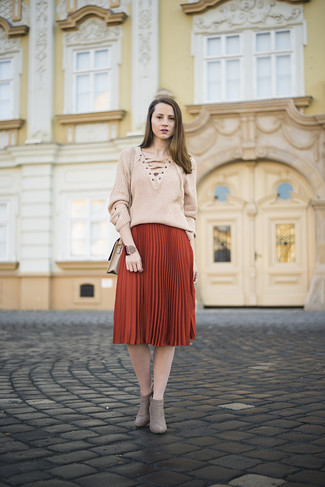 How to wear: beige leather crossbody bag, grey suede ankle boots, red pleated midi skirt, beige v-neck sweater