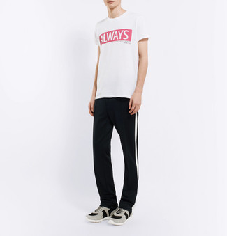 How to wear: grey athletic shoes, black and white vertical striped sweatpants, white and red print crew-neck t-shirt