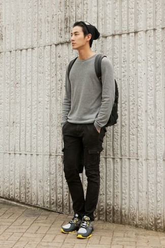 How to wear: black leather backpack, grey athletic shoes, black cargo pants, grey crew-neck sweater