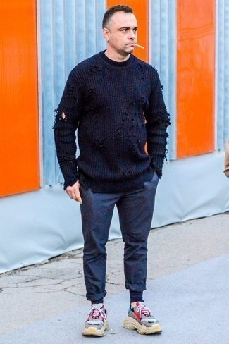 How to Wear a Navy Crew-neck Sweater For Men: Combining a navy crew-neck sweater and navy chinos will cement your expertise in men's fashion even on off-duty days. Grey athletic shoes will add edginess to an otherwise standard ensemble.