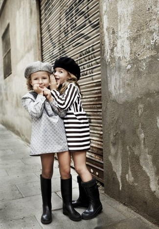 How to Wear Black Rain Boots For Girls: Teach your tot how to look put-together and stylish by suggesting that she opt for grey dress. As far as footwear is concerned, let your little girl throw in a pair of black rain boots.
