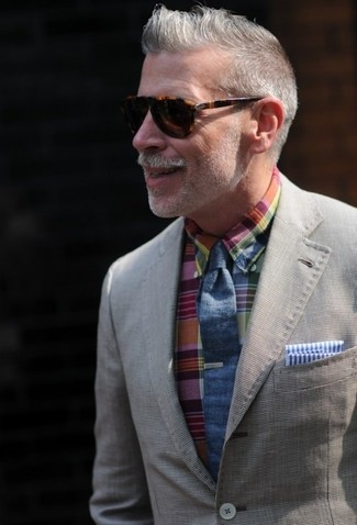 This combo of a grey cotton coat and a multi colored plaid button-down shirt will add a graceful essence to your getup. This combination is basically a lesson in how to dress for hot summer weather.