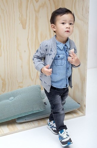 How to wear: grey print bomber jacket, light blue denim long sleeve shirt, charcoal jeans, blue sneakers