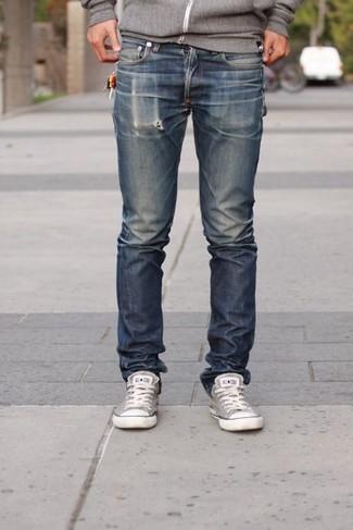 How to wear: grey canvas low top sneakers, navy jeans, grey hoodie