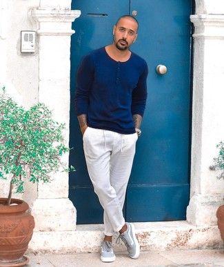 How to wear: grey canvas low top sneakers, white chinos, navy henley sweater
