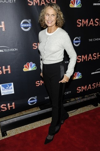Lauren Hutton wearing Grey Cardigan, White Crew-neck T-shirt, Black Dress Pants, Black Suede Pumps