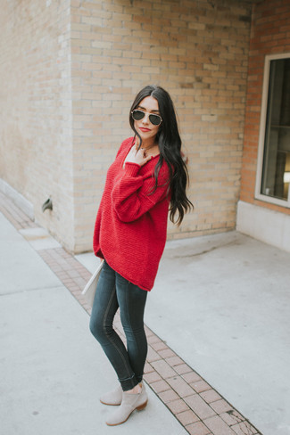 How to wear: black sunglasses, grey suede chelsea boots, black skinny jeans, red oversized sweater