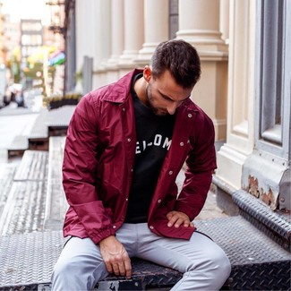 How to wear: grey chinos, black and white print crew-neck t-shirt, burgundy windbreaker