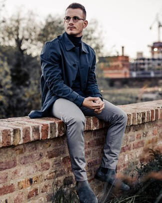 How to wear: charcoal suede chelsea boots, grey chinos, black turtleneck, navy raincoat