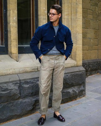 How to wear: burgundy leather loafers, grey chinos, light blue crew-neck sweater, navy wool shirt jacket