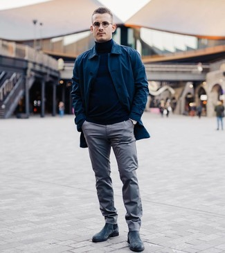 How to wear: navy suede chelsea boots, grey chinos, navy turtleneck, navy raincoat