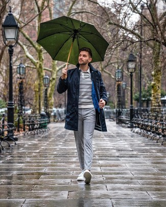 How to wear: white low top sneakers, grey check chinos, white and navy horizontal striped polo neck sweater, navy raincoat